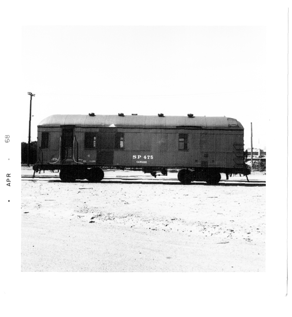 Southern Pacific passenger car that has been turned into a caboose.