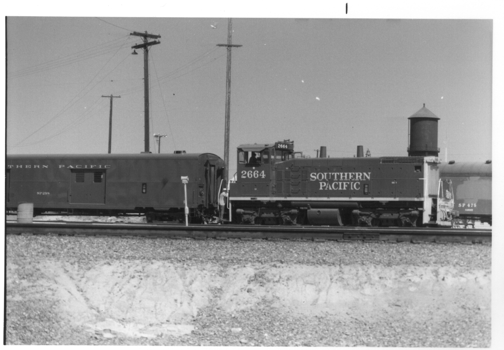 Southern Pacific engine and baggage car in San Jose by water tower.