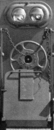 Close up of front of engine with chains and brake wheel.