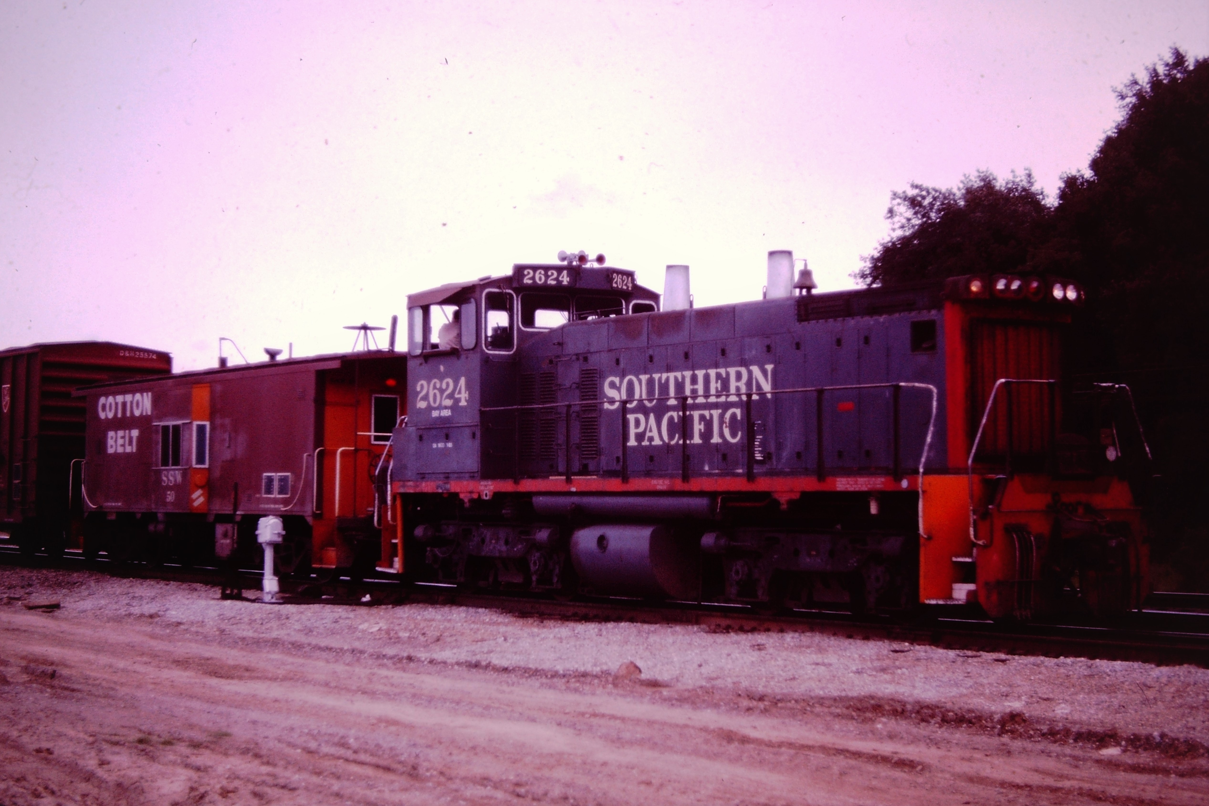 SP 2624 a SW1500 with a Caboose