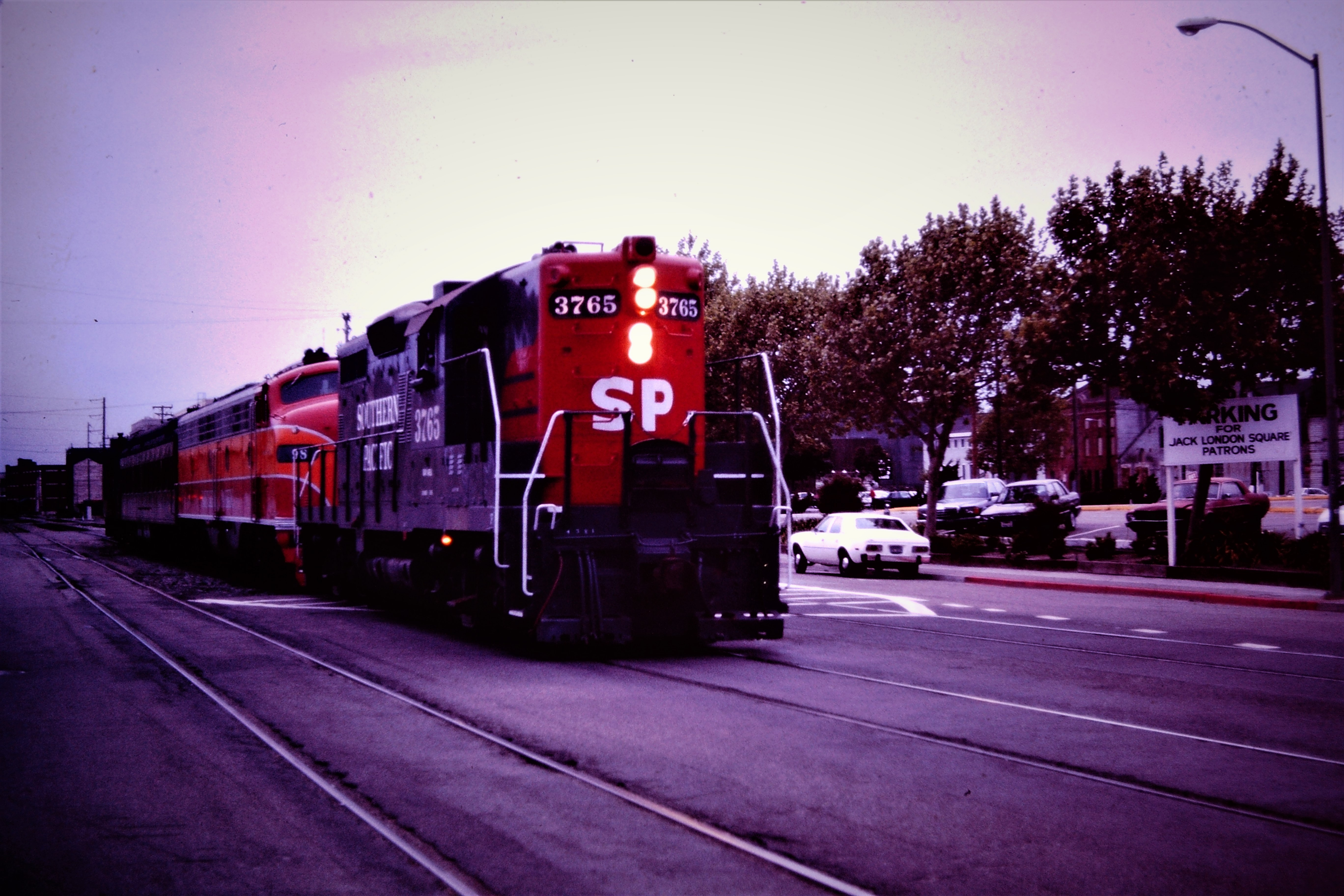 """MAY 1985 in Oakland, Ca. I suspect a """"museum"""" move of some sort. SP 3765 lights ablaze at Jack London Square."""